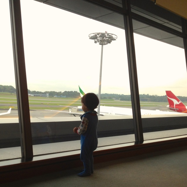 E doing a bit of plane spotting before boarding...